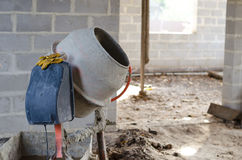 Old dirty cement mixer at a construction site. Old dirty cement mixer at a construction site Royalty Free Stock Photography