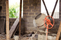Old dirty cement mixer at a construction site. Old dirty cement mixer at a construction site Royalty Free Stock Image