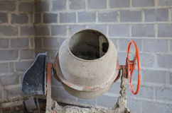 Old dirty cement mixer at a construction site. Old dirty cement mixer at a construction site Stock Images