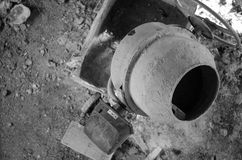 Old dirty cement mixer at a construction site. Old dirty cement mixer at a construction site Royalty Free Stock Images