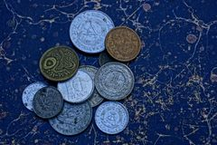Old dirty coins on a pile on a table royalty free stock photography