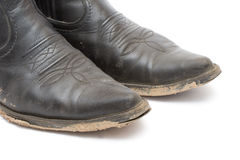 Old dirty cowboy boots Royalty Free Stock Image