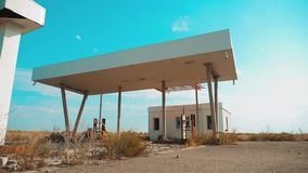 Old dirty deserted gas lifestyle station. U.S. Route 66. crisis road 66 fueling slow motion video. closed supermarket. Store shop Abandoned gas station oil end stock footage