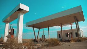 Old dirty deserted gas station lifestyle. U.S. Route 66. crisis road 66 fueling slow motion video. closed supermarket. Store shop Abandoned gas station oil end stock video footage