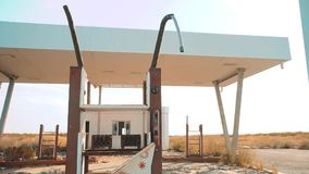 Old dirty deserted gas station. U.S. Route 66. crisis road 66 fueling lifestyle slow motion video. closed supermarket. Store shop Abandoned gas station oil end stock video footage