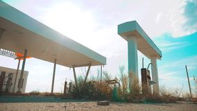 Old dirty deserted gas station. U.S. Route 66. crisis road 66 fueling slow motion video. closed supermarket store shop. Abandoned gas station oil end of stock video footage