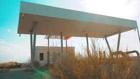 Old dirty deserted gas station. U.S. Route 66. crisis road 66 fueling slow motion video. closed supermarket store shop. Abandoned gas station oil end of fuel stock video