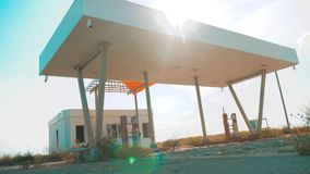 Old dirty deserted gas station. U.S. Route 66. crisis road 66 fueling slow motion video. closed supermarket store shop. Abandoned gas station oil end of fuel stock video footage