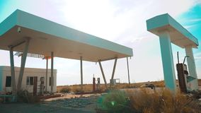 Old dirty deserted gas station. U.S. Route 66. crisis road 66 fueling slow motion video. closed supermarket store shop. Abandoned gas station lifestyle oil end stock video