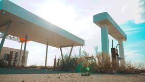 Old dirty deserted gas station. U.S. Route 66. Crisis road 66 fuelling slow motion video. closed supermarket store shop. Abandoned gas station oil end lifestyle stock footage
