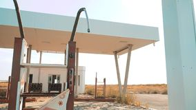 Old dirty deserted gas station. U.S. Route 66. crisis road lifestyle 66 fueling slow motion video. closed supermarket. Store shop Abandoned gas station oil end stock video footage