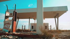 Old dirty deserted gas station. U.S. Route lifestyle 66. crisis road 66 fueling slow motion video. closed supermarket. Store shop Abandoned gas station oil end stock footage