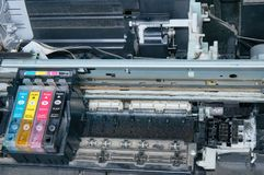 Old, dirty, disassembled ink jet printer. View of internal parts. Closeup Stock Images