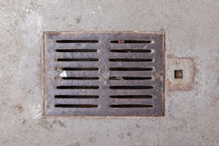 Old dirty drain grate Stock Image