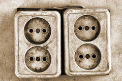 Old dirty electrical outlets Stock Image