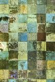 Old dirty enamel mosaic i Royalty Free Stock Photos