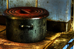 Old dirty enamel pot. On stove Royalty Free Stock Photography
