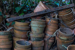 Old dirty flower pots stacked in garden Royalty Free Stock Images