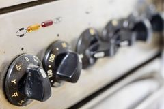 An old dirty gas kitchen. Device for preparing dishes in the kit. Chen. Dark background Stock Photo