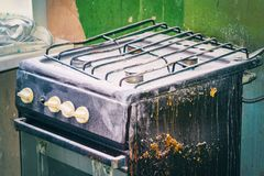 Old dirty gas stove in an abandoned state. An old dirty gas stove in an abandoned state. Unsanitary conditions Royalty Free Stock Photos