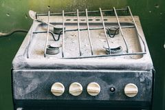 Old dirty gas stove in an abandoned state. An old dirty gas stove in an abandoned state. Unsanitary conditions Royalty Free Stock Photo