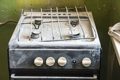 Old dirty gas stove in an abandoned state. An old dirty gas stove in an abandoned state. Unsanitary conditions Stock Photos