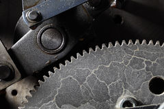 Old dirty gearwheel in work Stock Images