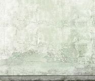 Old dirty grey building wall with scuff marks, cracks and stains. royalty free stock photos