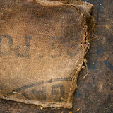 Old dirty hessian sack bag stamped used as upholstery material. Background royalty free stock image