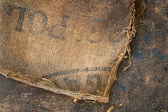 Old dirty hessian sack bag stamped used as upholstery material. Background stock photos