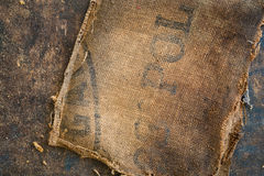 Old dirty hessian sack bag stamped used as upholstery material. Background royalty free stock images