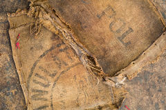 Old dirty hessian sack bag stamped used as upholstery material. Background royalty free stock photo
