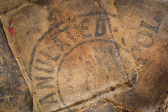 Old dirty hessian sack bag stamped used as upholstery material. Background royalty free stock photography