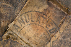 Old dirty hessian sack bag stamped used as upholstery material. Background stock photo