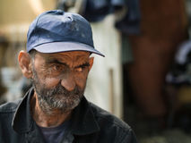 Old and dirty homeless man. Sad old homeless man portrait Stock Images