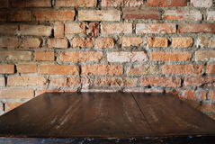 Old dirty interior with brick wall, vintage background Stock Photos