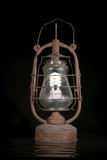 The old dirty kerosene lamp with modern  bulb Stock Image