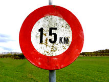 Old dirty 15 km per hour speed sign with meadow background Royalty Free Stock Photo