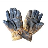 Old dirty leather work gloves isolated on white background. Pair of old dirty leather work gloves isolated on white background stock image