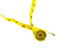 Old and dirty measuring tape on white. Royalty Free Stock Images