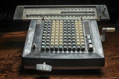 Old dirty mechanical calculator Royalty Free Stock Photography