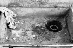 Old dirty metal rusty sink Royalty Free Stock Photo