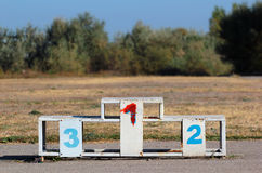 Old dirty metal white medal podium with numbers Stock Photo