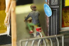 Old and dirty miniature plastic figure model ride bicycle. Stock Photography