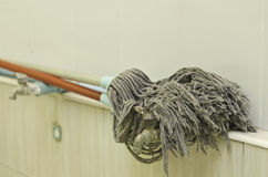 Old dirty mop Stock Photography