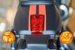 Motorcycle brake light. Old and dirty motorcycle tail lights tail lamp or rear lights with selective focus and vintage effect royalty free stock image