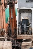 Old abandoned digger. Old dirty neglected and abandoned digger on a building site stock photo