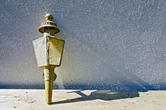 Old dirty oil lamp for carriages Stock Photography