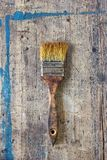 Old, dirty paint brush against wooden plank. Tool series stock photos