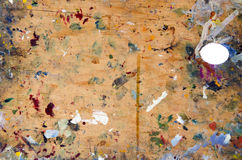 Old dirty painter art palette plywood backgroud royalty free stock photo